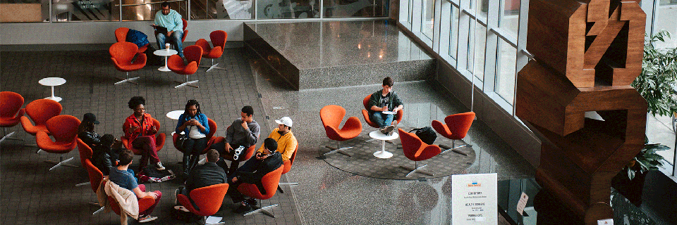 Students working together in a circle in the campus center.