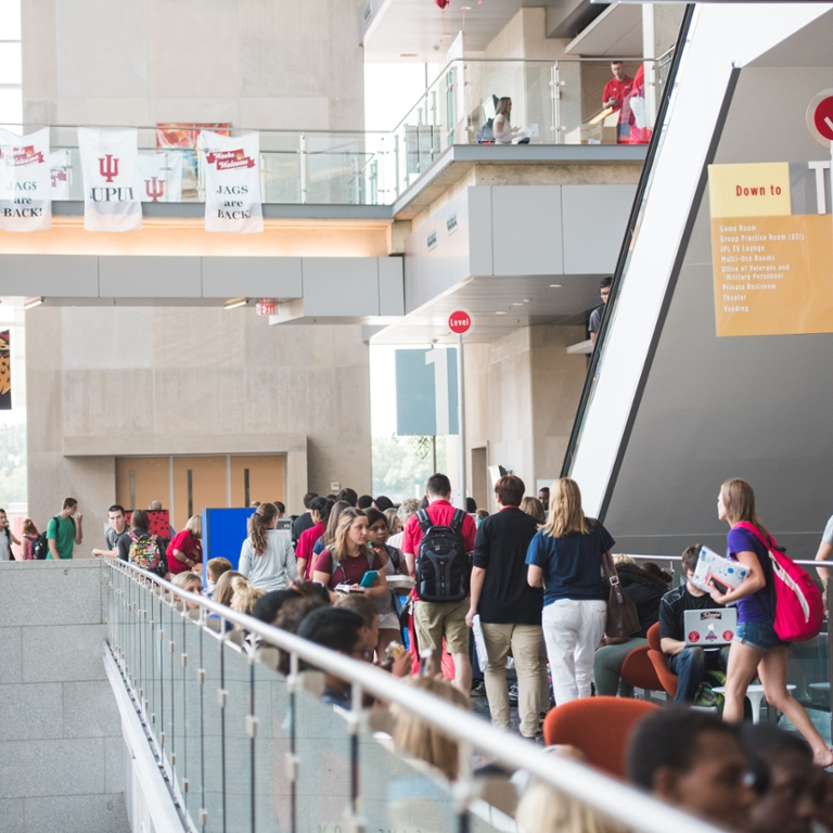 The campus center with many students.